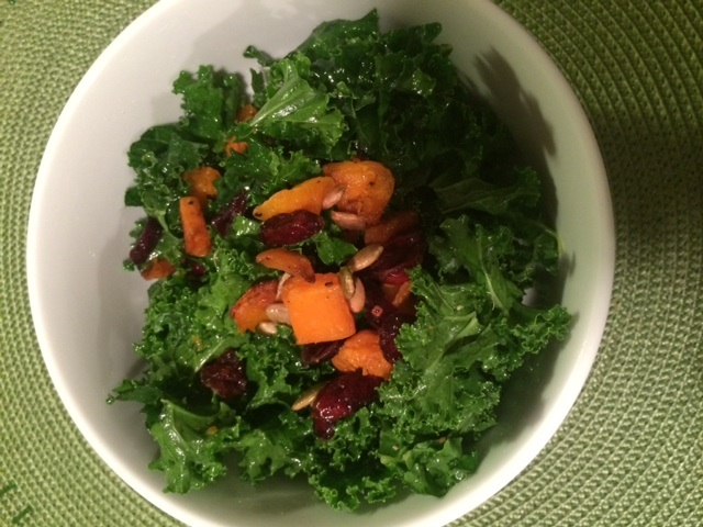 Kale salad with butternut squash, pepitas, dried cranberries and lemon/olive oil dressing