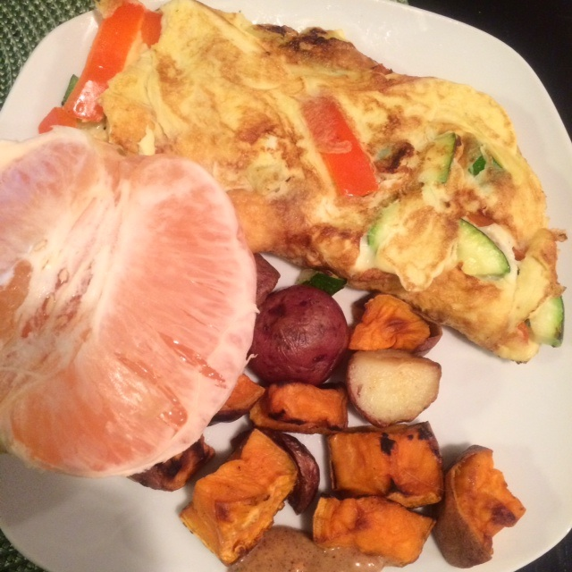 2 Whole eggs, roasted sweet and white potatoes, 1/2 grapefruit and mixed veggies in the eggs